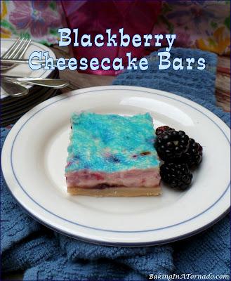 Blackberry Cheesecake Bars, creamy cheesecake filling featuring blackberries and vanilla are baked into jam topped shortbread crust.   recipe developed by www.BakingInATornado.com   #recipe #dessert
