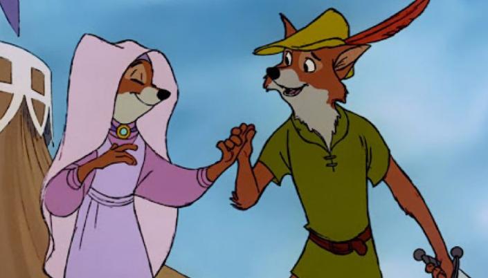 Imagem: a Lady Marian, uma raposa em um véu roa claro com um vestido em tons claros de roxo e um colar dourado dando a mão para o Robin Hood, uma raposa sorridente com roupas em tons de verde e um chapéu com uma pena vermelha.