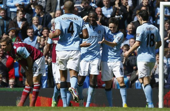 Yaya Touré celebrates his goal against West Ham with Manchester City teammates
