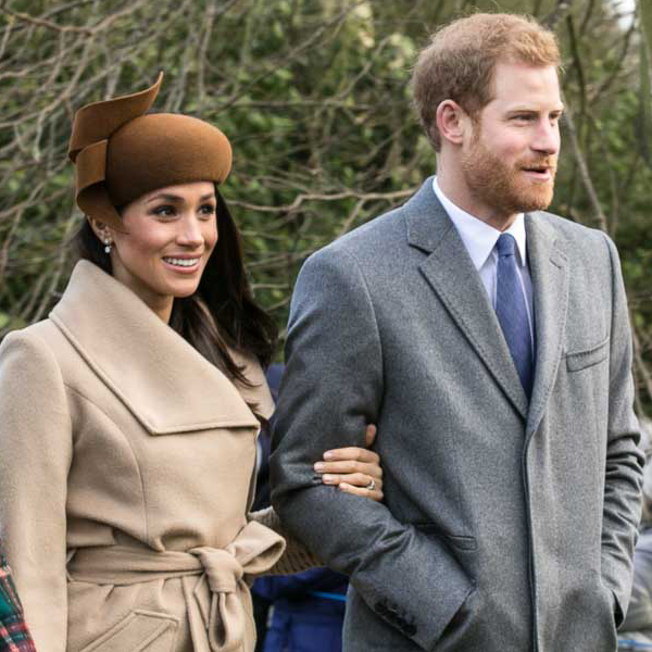 Prince Harry (right) arm-in-arm with Meghan, who's wearing a beige hat