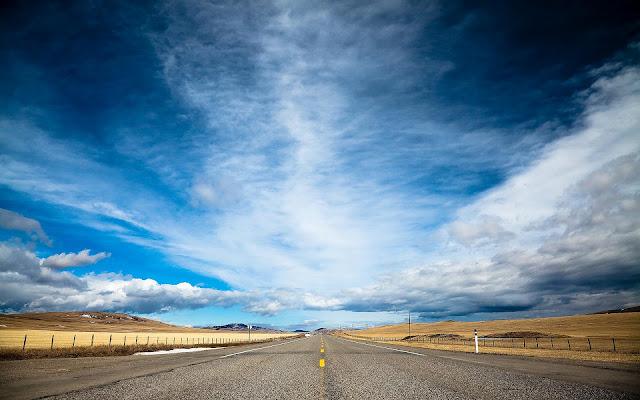 Landschap met een lange weg