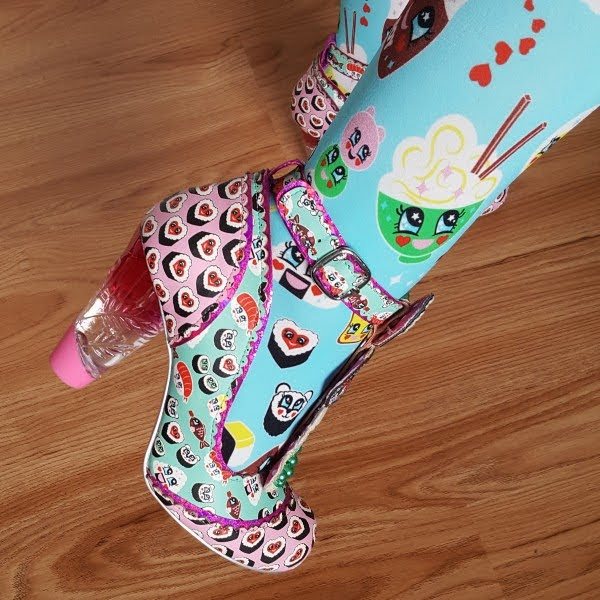 close up wearing perspex heeled shoe with sushi theme