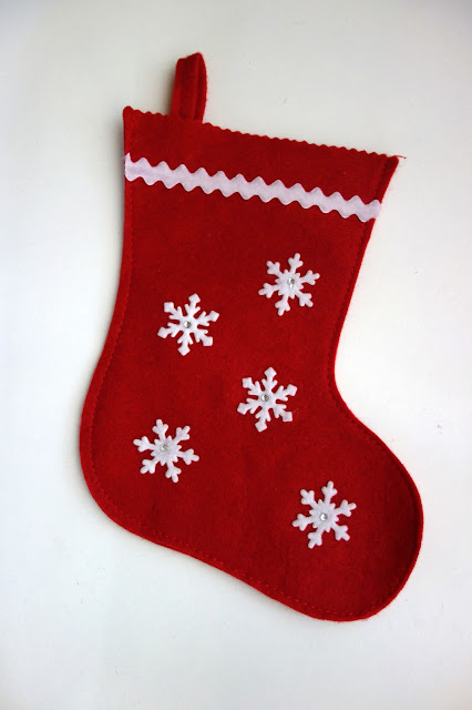 sewing on a stocking, monogram on a stocking, felt stocking, stocking embroidery