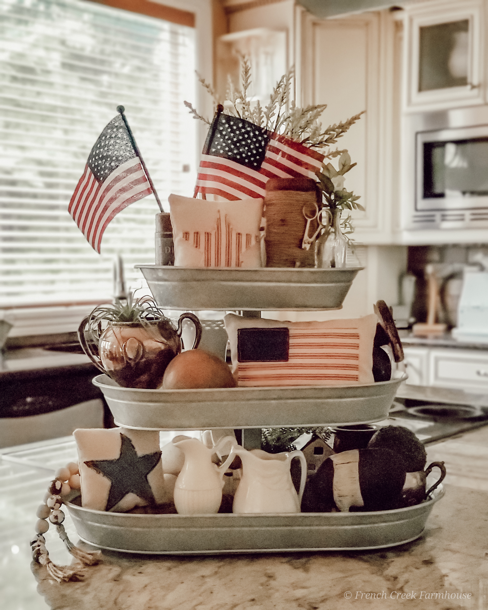 3-Tiered tray with patriotic decor on kitchen island
