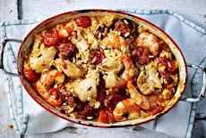 دجاج مشوي ، روبيان و أرز وchorizo فى الفرن