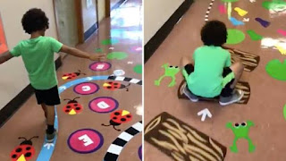 small boy leaping from image to image painted on the floor of a school hallway; Removing the Stumbling Block