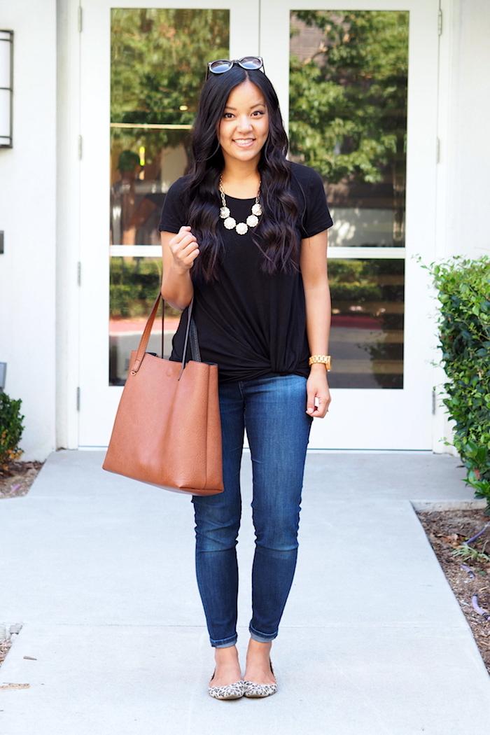 black twist tee + jeans + statement necklace + leopard flats