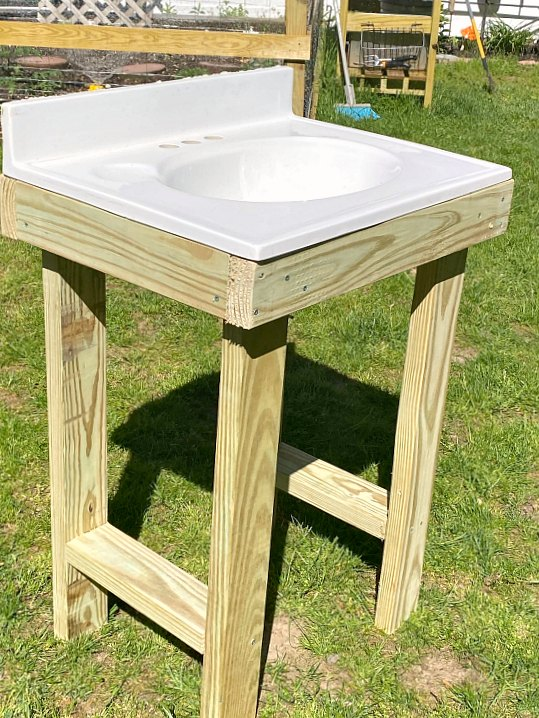 outdoor sink in a pressure treated wood frame