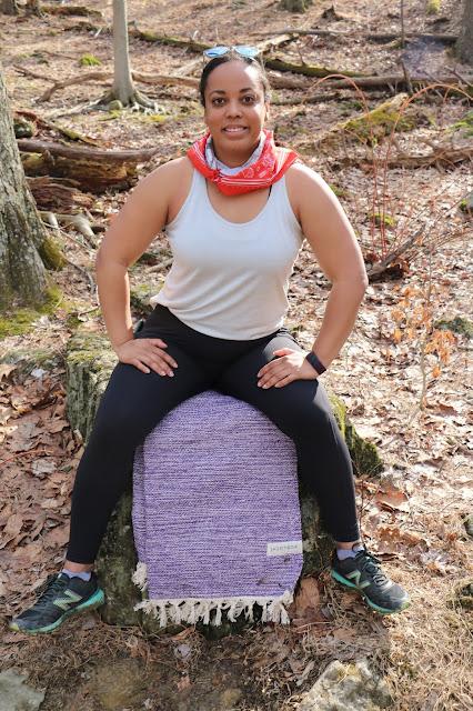 Black woman yogi in the woods