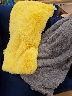 furry yellow and gray throws