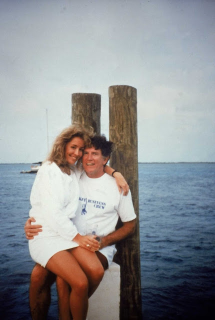 Donna Rice and Gary Hart sitting on a dock in Bimini (1987)