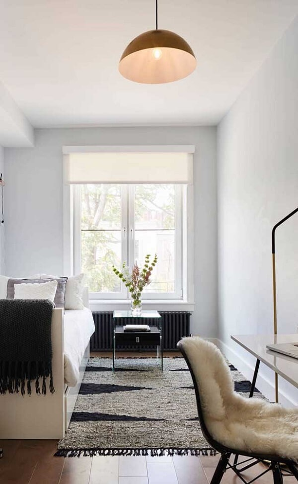 Natural lighting enhances the presence of the widow's bed in the room