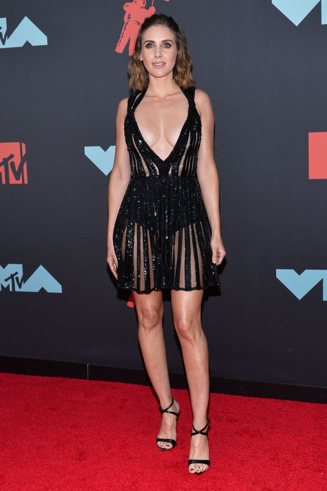 Alison Brie bares impressive cleavage at the 2019 MTV VMAs