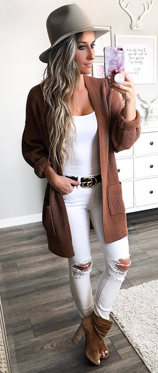 trendy fall outfit / hat + cardigan + white top + ripped jeans + boots