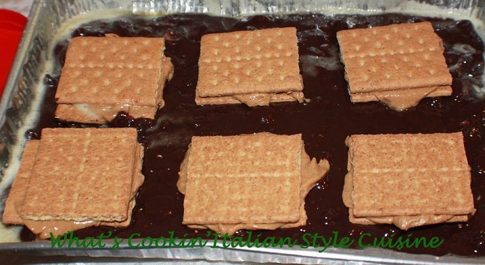 These are stuffed brownie with peanut butter and graham crackers. They are in a 13 x 9 sheet pan that is aluminum and ready to bake