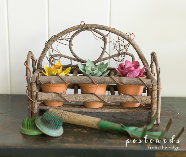 egg carton flowers with vintage garden tools