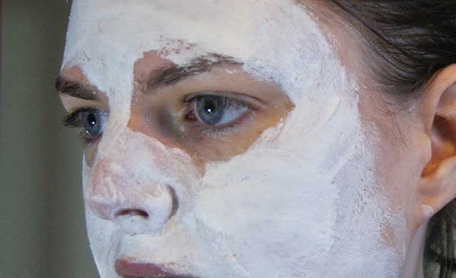 Origins Out of Trouble Mask on Face