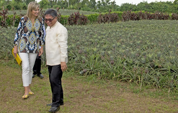 Filipino pineapple growers, during her visit at a Pineapple farm in Tagaytay City, south of Manila, Philippines