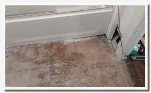 how to level a bathroom floor before tiling