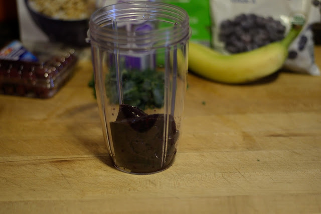 The acai puree placed into the blender.