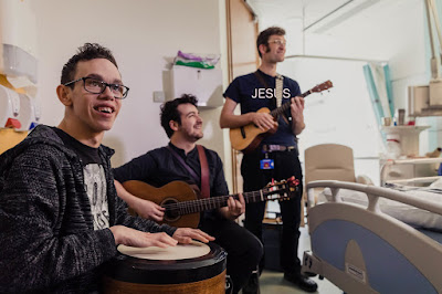 Christian band singing in a hospital ward
