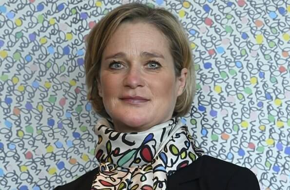 Princess Delphine of Belgium wore a black belted blazer and silk satin print scarf from Saxe-Coburg. Professor Tessa Kerre is president of the fund