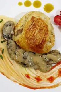 Golden brown Steak Pie served on a bed or mushrooms and spaghetti. Perfectly dressed Cobb salad and mashed potatoes.