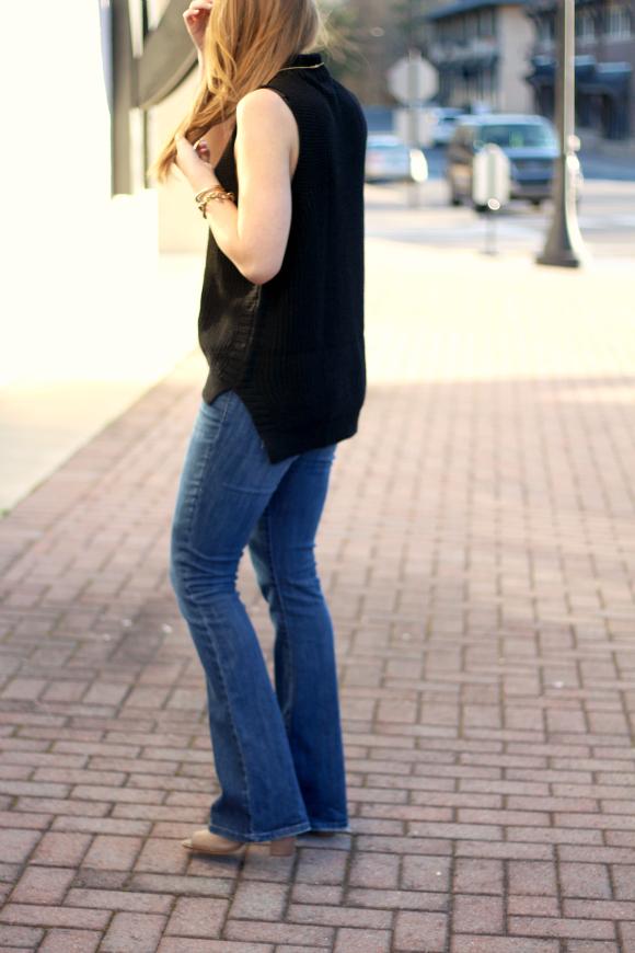 black sleeveless turtleneck