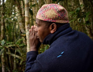African man talking to a tree in a ritual