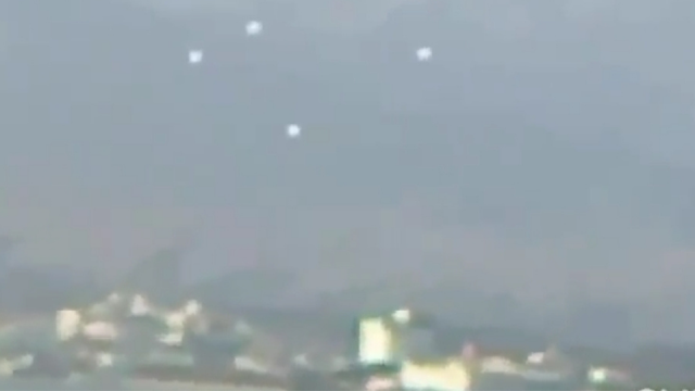 UFO Orbs in formation over nuclear power station in Japan.