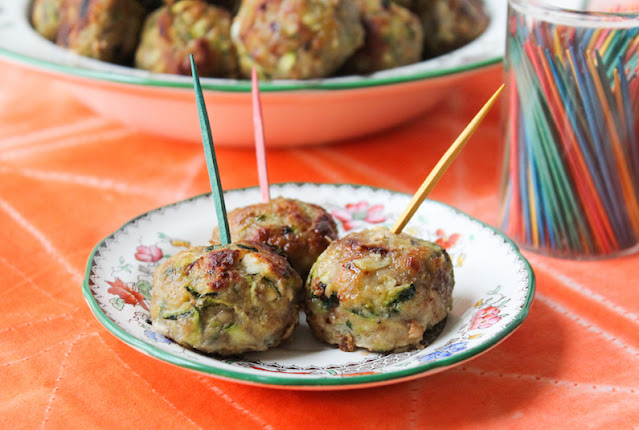 Food Lust People Love: These Turkey Zucchini Feta Meatballs are delicious just as they are, baked till golden, as an appetizer or add them to a sauce to serve with pasta. It's kind of magical how the zucchini seems to disappear as they bake so objectors likely won't even notice it.