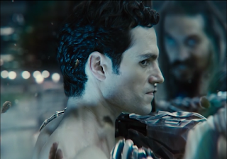 A Snyder Cut shot of Superman from the side, grappling with Aquaman, his eye turned to look at the Flash.