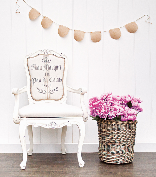 white painted chair with basket full of pink peonies