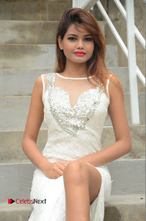 Actress Clara Farnandes Pictures in White Long Dress at Lovers Park Movie Opening  0063.JPG