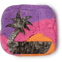 A light rounded squared purple yellow and slightly red bubble bar with some embedded lavender seeds in it on a bright background