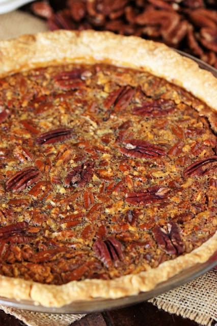 Whole Pecan Pie Made with Vanilla Pudding Mix in Pie Dish Image
