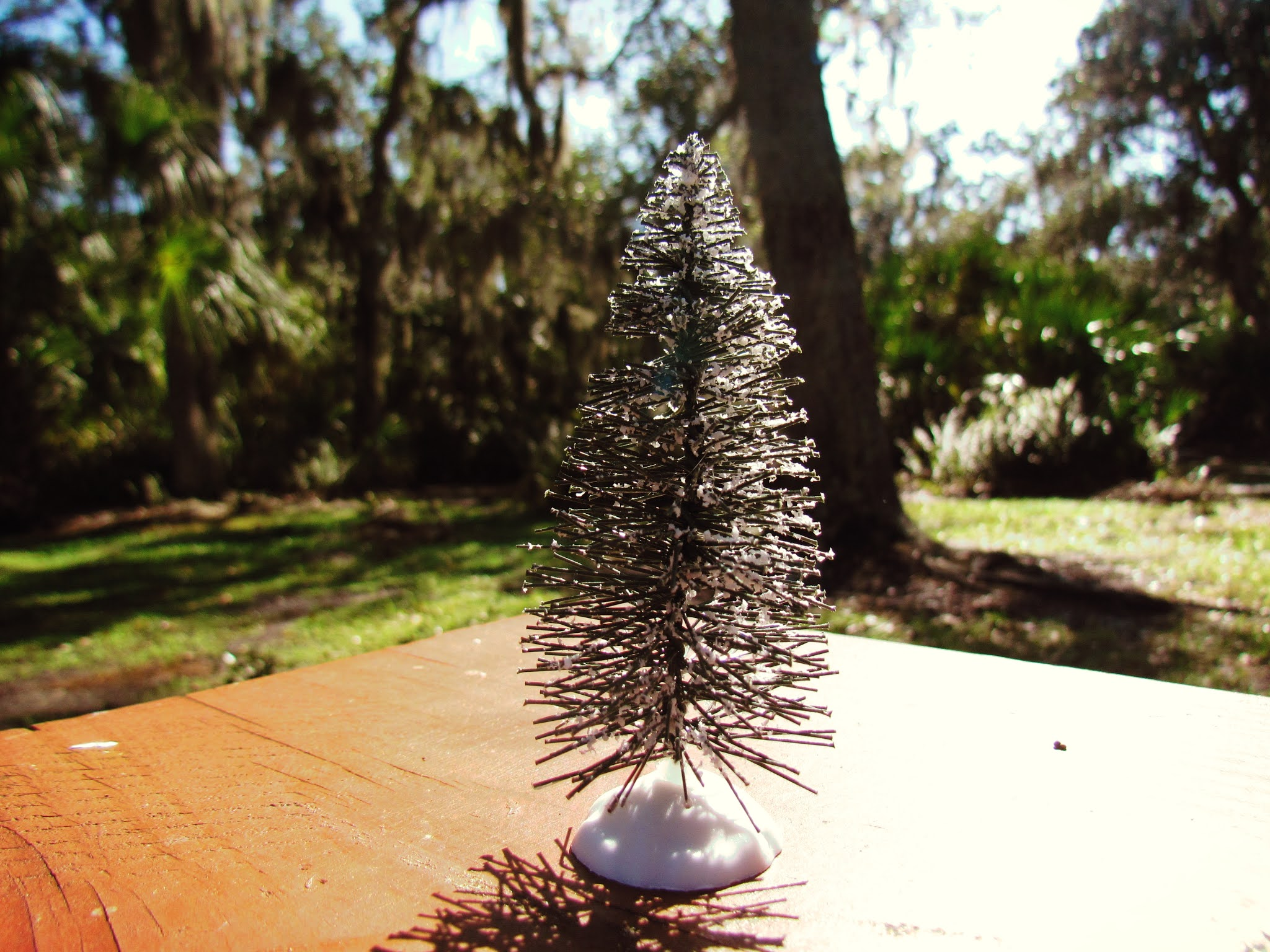A fake plastic Christmas Tree in a Florida outdoor dining area for poetry readings