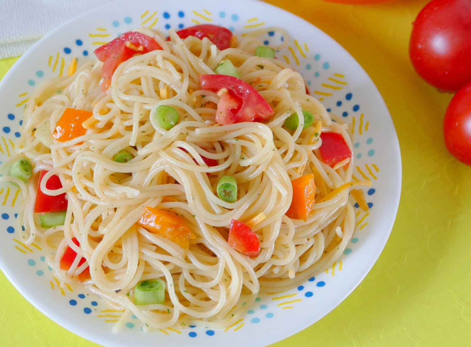 This simple pasta salad is great for any spring or summer BBQ, potluck, meal or picnic! The ranch adds delicious flavor to the pasta, tomatoes, green onions and bell pepper. Plus there's no mayo which makes it versatile and easy to customize!