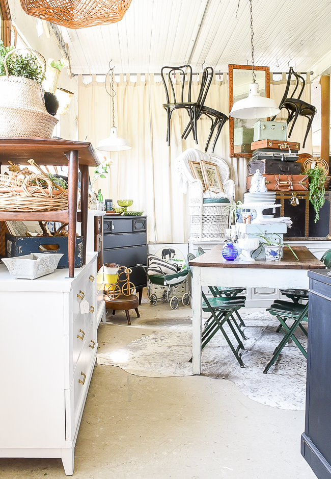 Overview of a vintage booth styled with unique vintage industrial finds in cool blues and greens.