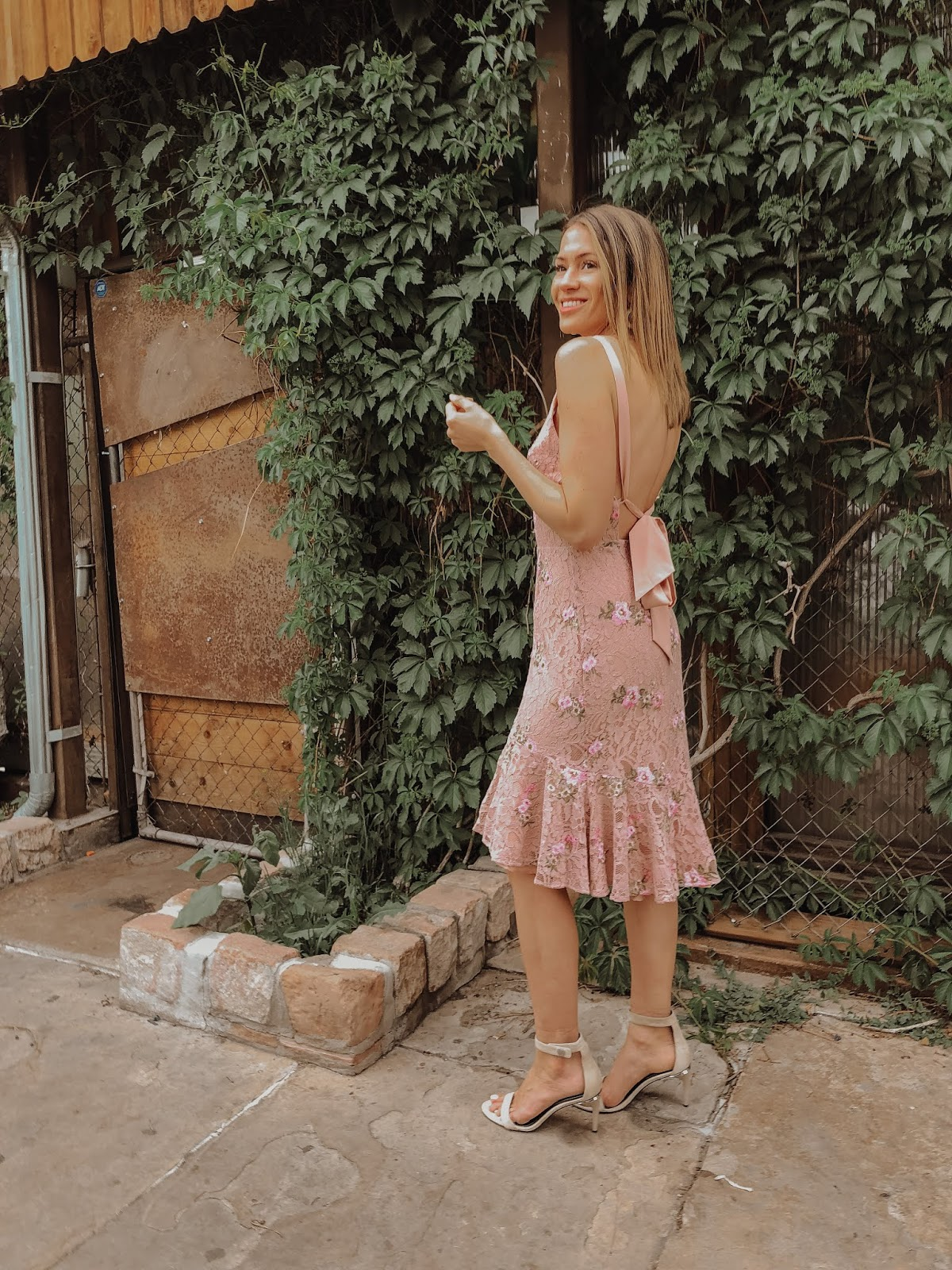 One of the Most Beautiful Spring Wedding Guest Dresses styled by popular Colorado fashion blogger, Leah Behr