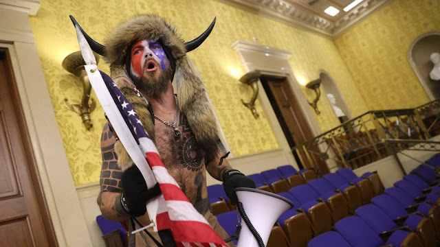 Shirtless man with an horn and a painted face during the US Capitol Riot has been arrested
