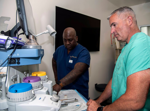 Navy Cmdr. Jerrol Wallace (left) and Dr. Matthew D'Angelo (right) prepare for a teaching exercise in the anesthesia simulation lab.
