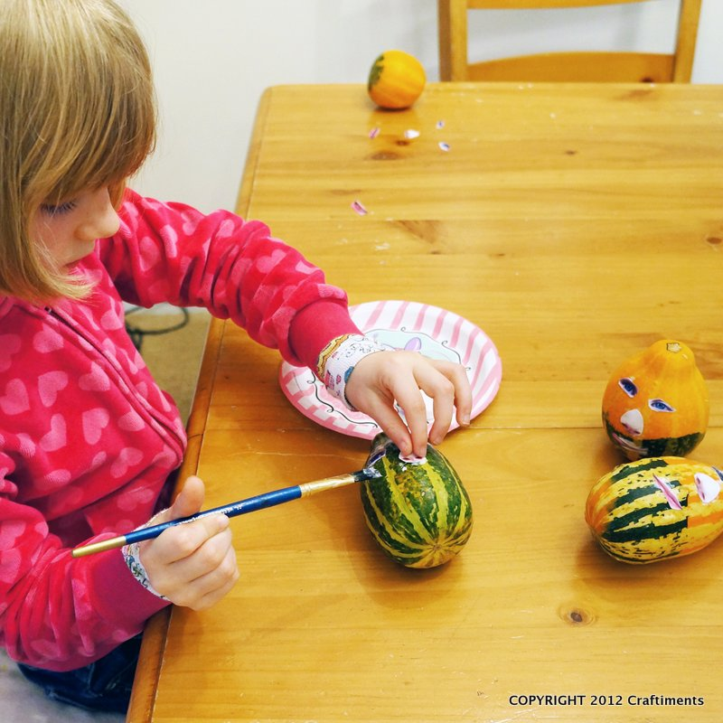 gluing faces to the gourds