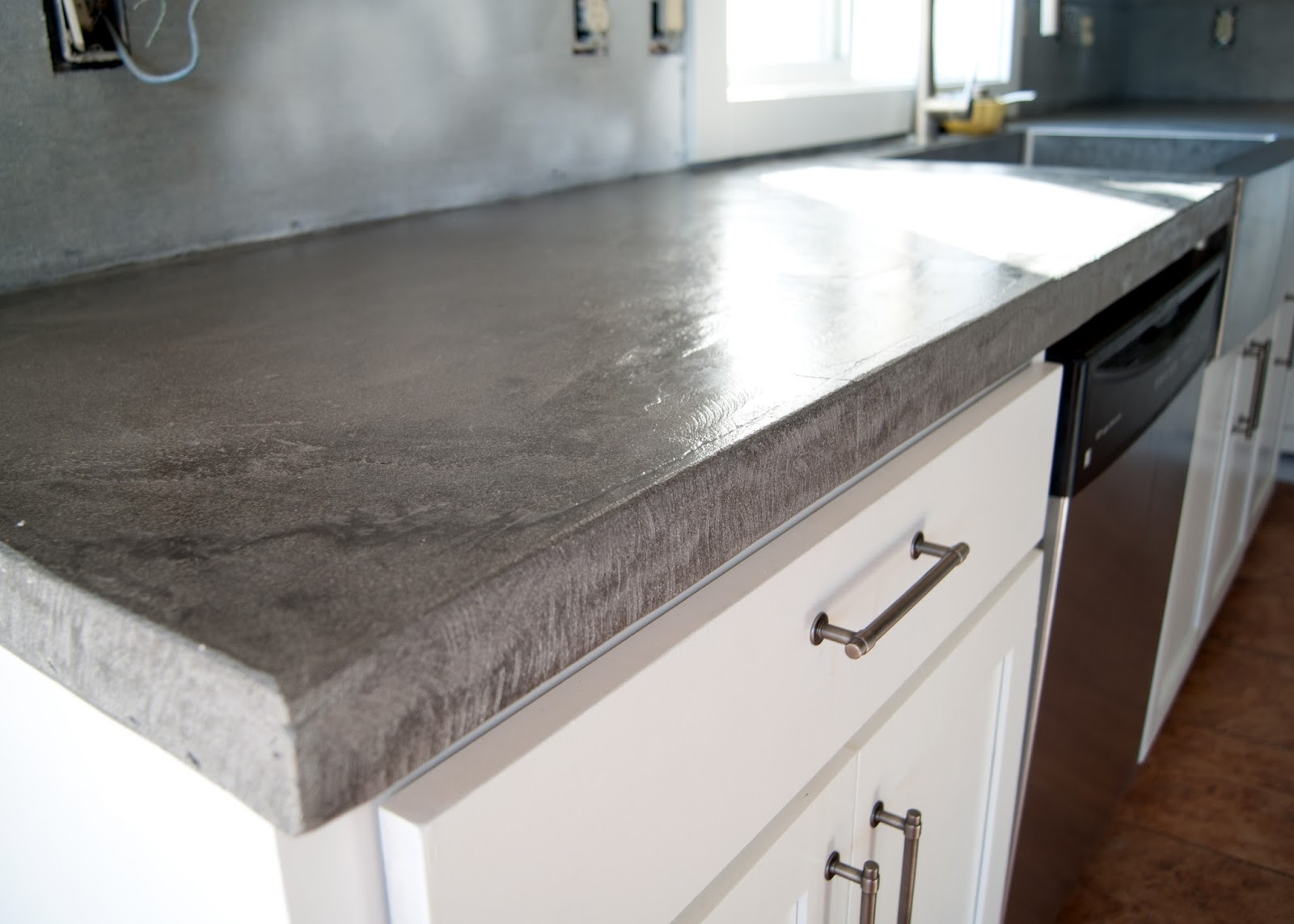 diy concrete counters poured over concrete kitchen countertops Wet look sealer applied to concrete counters for a shiny finish