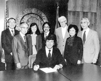 Mayor Charles Royer of Seattle, Washington, signs the proclamation for the Day of Remembrance, Nov. 1978, Seattle, Washington.