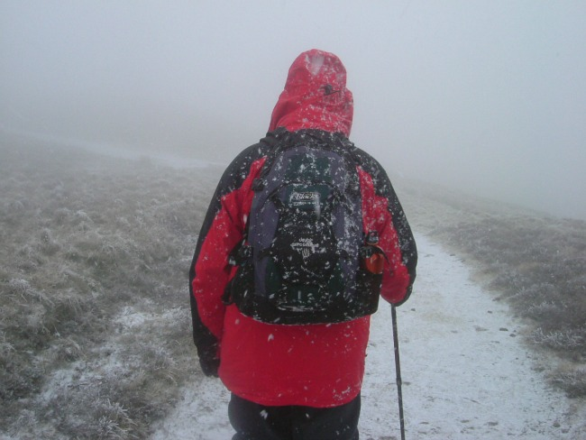 Essential-items-For-Walking-In-The-Mountains-In-South-Wales-man-walking-in-fog