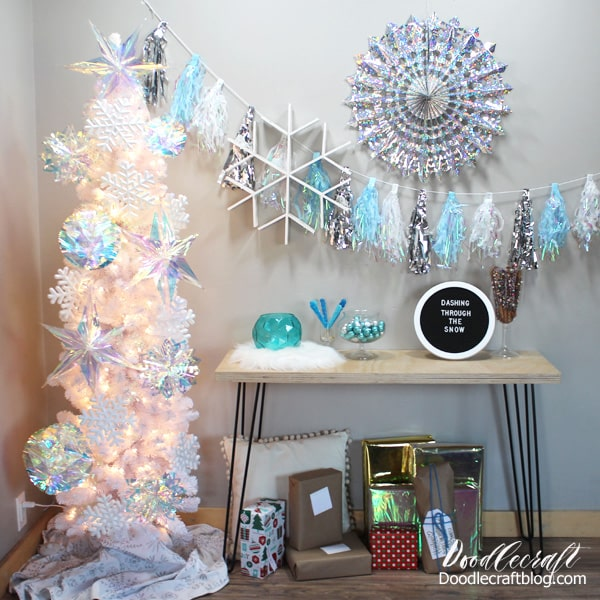 Frozen birthday party with silver and blue snowflakes, iridescent decorations, textures and lots of yummy food...plus becomes holiday decor for the Christmas tree after the party.