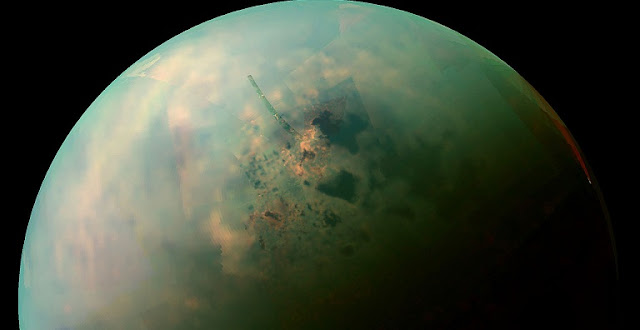 A false-color, near infrared view of Titan's northern hemisphere collected by NASA's Cassini spacecraft showing the moon's seas and lakes. Orange areas near some of them may be deposits of organic evaporite minerals left behind by receding liquid hydrocarbon. Credit: NASA / JPL-Caltech / Space Science Institute