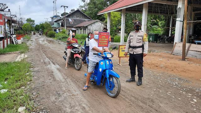Personel Polsek Pandih Batu Cek Kepatuhan Masyarakat Terhadap Protokol Kesehatan