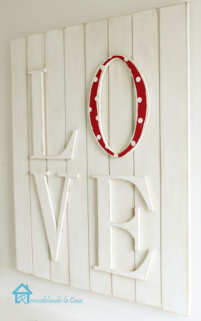 love wall art with red polka dot letter o